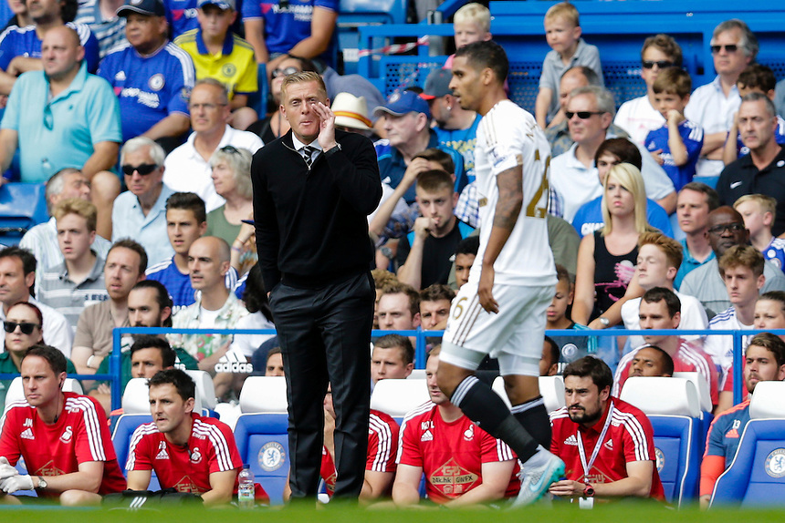 Swansea City manager Garry Monk shouts instructions to his team from the dug-out<br /> <br /> Photographer Craig Mercer/CameraSport<br /> <br /> Football - Barclays Premiership - Chelsea v Swansea City - Saturday 8th August 2015 - Stamford Bridge - London<br /> <br /> &copy; CameraSport - 43 Linden Ave. Countesthorpe. Leicester. England. LE8 5PG - Tel: +44 (0) 116 277 4147 - admin@camerasport.com - www.camerasport.com