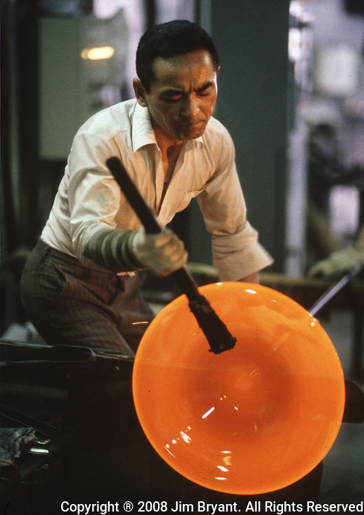 An artisan shapes a glass bowl with the help of man made tools  at the Hokuyo Glass Manufacturing Company's  Blown Glass Factory in Aomori, Japan. Glass blowers at the factory churn out between 1,500 and 2,000 pieces of glass daily. (Jim Bryant Photo).....