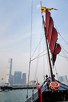 Hong Kong, harbour, 21 April, 2012..A harbour cruise on the Aqua Luna is very popular with tourists. the Aqua Luna is built like a classic Chinese junk with modern amenities..From the boat at sunset the Hong Kong skyline is as spectacular as ever...Photo Kees Metselaar