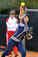 11 February 2012:  FIU's Jessy Alfonso (8) throws to first as the University of Louisville Cardinals defeated the FIU Golden Panthers, 4-2, as part of the COMBAT Classic at the FIU Softball Complex in Miami, Florida.