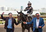HALLANDALE BEACH, FL - March 31: Owners Rick Pitino and Roddy Valente celebrate with jockey Luis Saez on his win aboard Coach Rocks for Trainer Dale Romans after the Gulfstream Park Oaks at Gulfstream Park on March 31, 2018 in Hallandale Beach, FL. (Photo by Carson Dennis/Eclipse Sportswire/Getty Images.)