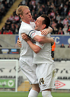 Pictured: Stephen Dobbie (R) of Swansea celebrating his opening goal with Alan Tate (L). Saturday 07 May 2011<br /> Re: Swansea City FC v Sheffield United, npower Championship at the Liberty Stadium, Swansea, south Wales.
