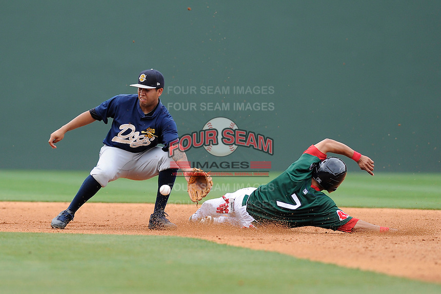 Shortstop Cito Culver (23) of the Charleston RiverDogs waits for the throw as Mookie Betts (7) of the Greenville Drive steals second base in a game on Sunday, May 19, 2013, at Fluor Field at the West End in Greenville, South Carolina. Charleston won, 9-7. (Tom Priddy/Four Seam Images)