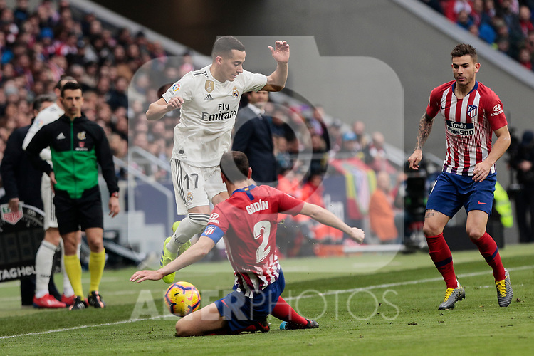 Atletico de Madrid's Diego Godin and Real Madrid's Lucas Vazquez during La Liga match between Atletico de Madrid and Real Madrid at Wanda Metropolitano Stadium in Madrid, Spain. February 09, 2019. (ALTERPHOTOS/A. Perez Meca)