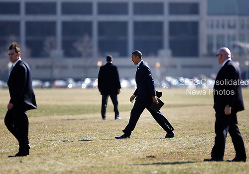 United States President Barack Obama walks to depart via Marine One helicopter from a landing zone at the U.S. Naval Academy in Annapolis, Maryland on Wednesday, February 6, 2013. Obama attended the Senate Democratic Issues Conference at a nearby hotel. .Credit: Jonathan Ernst / Pool via CNP