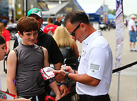 Apr 24, 2015; Baytown, TX, USA; NHRA top fuel driver Steve Torrence signs autographs during qualifying for the Spring Nationals at Royal Purple Raceway. Mandatory Credit: Mark J. Rebilas-