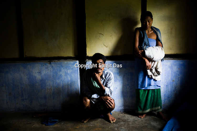 One of the victims of ethnic violence, Johendra Longmailai is seen with his wife, Joiso Longmalai at the community centre in Jorai village. Ethnic clashes are regularly taking place between Zeme Nagas and the Dimasa tribe in North Cachar Hills in Assam, India. On 8th May 200, suspected Zeme Naga groups attacked a Dimasa village and burnt down 10 out of 13 houses. In this act of violence, they spared the school and the community centre, where most of the families are taking shelter.