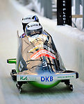 18 December 2010: Cathleen Martini crosses the finish line as she pilots her 2-man bobsled for Germany, taking the silver at the Viessmann FIBT World Cup Bobsled Championships on Mount Van Hoevenberg in Lake Placid, New York, USA. Mandatory Credit: Ed Wolfstein Photo