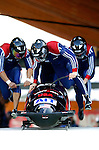 20 November 2005: Steven Holcomb leads the USA 3 sled pushoff in the first run of the 2005 FIBT AIT World Cup Men's 4-Man Bobsleigh Tour, piloting the team to a 6th place finish at the Verizon Sports Complex, in Lake Placid, NY. Mandatory Photo Credit: Ed Wolfstein.