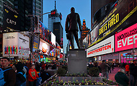 Billboards and evening crowds on Broadway, and statue of George M Cohan, 1878-1942, entertainer, playwright, composer, lyricist, actor, singer, dancer and producer, 1959, by Georg John Lober and architect Otto Langman, on Duffy Square, Times Square, New York, New York, USA. Broadway is the Theater District of Manhattan, with 41 professional theatres. Broadway is the oldest North-South street in New York City, and is 13 miles long. Picture by Manuel Cohen