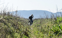 Pictured: A male migrant, makes his way through fields to Idomeni, Greece Wednesday 02 March 2016<br /> Re: More migrants have been arriving at the Greek FYRO Macedonian border of Idomeni, Greece.