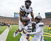 Ohio State Buckeyes running back Mike Weber (25) is congratulated after a touchdown by wide receiver Terry McLaurin (83) and quarterback Dwayne Haskins (7) during the second half of Saturday's NCAA Division I football game against the Michigan Wolverines at Michigan Stadium in Ann Arbor on November 25, 2017.  Ohio State won the game 31-20. [Barbara J. Perenic/Dispatch]
