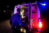 An illegal migrant looks out the back of a Borer Patrol vehicle after being spoted by a citizen and reported to officials near Green Valley, Arizona, August 9, 2009. In addition to traffic stops and drug busts, the sheriff department is primarily responsible for responding to dead body calls and body recovery and transfer from the desert to the medical examiners office in Tucson...PHOTOS/ MATT NAGER