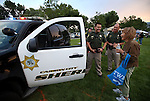 CCSO Reserve Deputies Huyrh and Dave Phillips talk with Ruth Rederburg at the 11th annual National Night Out hosted by the Carson City Sheriff's Office in Carson City, Nev., on Tuesday, Aug. 6, 2013. <br /> Photo by Cathleen Allison