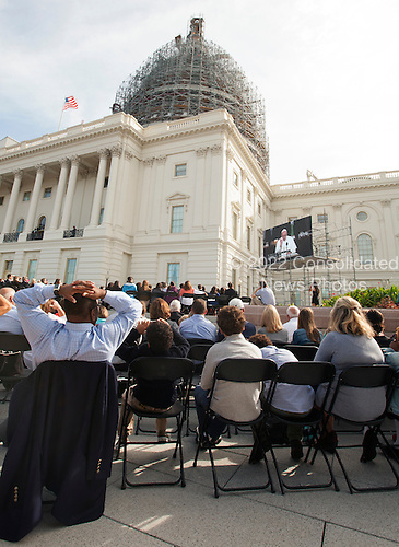 Ticket guests watch Pope Francis on monitors on the West Front of the United States Capitol in Washington, DC as he  delivers an address to a Joint Session of the US Congress in Washington, DC on Thursday, September 24, 2015.<br /> Credit: Chris Kleponis / CNP<br /> (RESTRICTION: NO New York or New Jersey Newspapers or newspapers within a 75 mile radius of New York City)