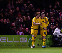 Milton Keynes Dons' Rhys Healey, right, celebrates scoring the opening goal with team-mate Dean Lewington<br /> <br /> Photographer Andrew Vaughan/CameraSport<br /> <br /> The EFL Sky Bet League One - Lincoln City v Milton Keynes Dons - Tuesday 11th February 2020 - LNER Stadium - Lincoln<br /> <br /> World Copyright © 2020 CameraSport. All rights reserved. 43 Linden Ave. Countesthorpe. Leicester. England. LE8 5PG - Tel: +44 (0) 116 277 4147 - admin@camerasport.com - www.camerasport.com
