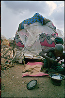 near Wajid, Somalia, March 2006.Ali Mohammed Kuln, 93, from Buswale, a former Italian Army soldier and a policeman for more than 35 years, has lost everything because of the drought..he is ressourceless and barely survives in this fragile shelter.