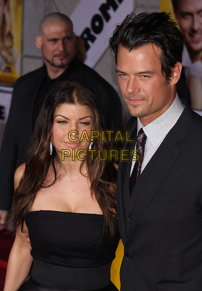 """FERGIE (STACY FERGUSON) & JOSH DUHAMEL .""""When In Rome"""" Los Angeles Premiere - Arrivals held at The El Capitan Theater, Hollywood, CA, USA, .27th January 2010..half length married couple husband wife black tie  grey gray shirt purple beard facial hair stubble tanned sun tan strapless .CAP/ADM/CH.©Charles Harris/AdMedia/Capital Pictures"""