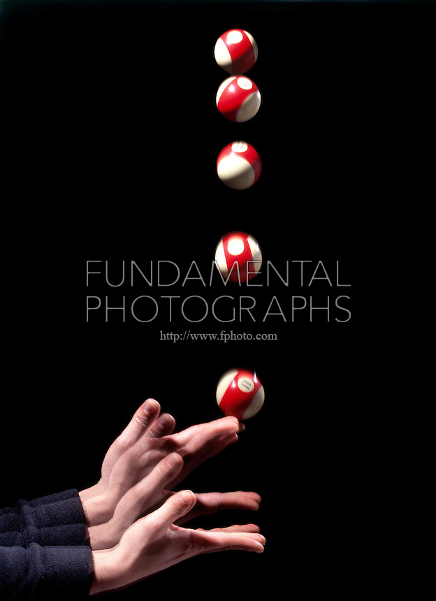 BILLIARD BALL THROWN IN THE AIR - STROBOSCOPIC IMAGE<br /> The Ball Has Downward Acceleration As Soon As It's Released<br /> With an initial upward velocity of +10.5 m/s, the acceleration of the ball is -9.81 m/sec2.  The negative acceleration slows the velocity to 0 m/s at which point the ball reaches the peak of its upward motion and is about to move downward.