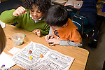 Education Elementary School New York Grade 3 mathematics children playing homemade game horizontal two boys playing