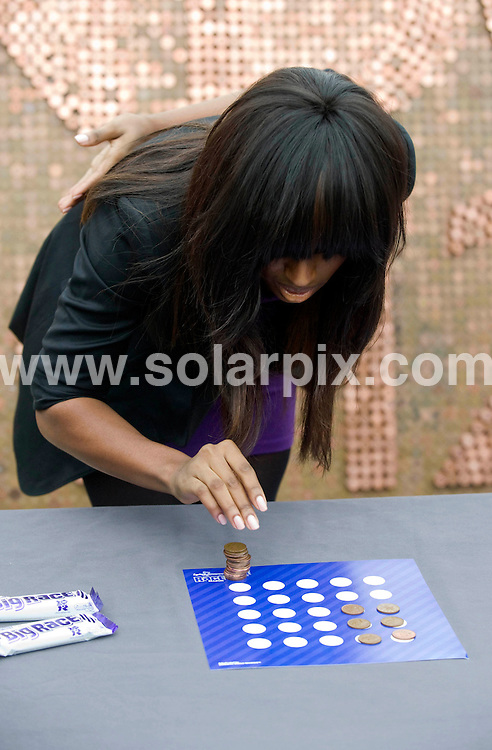 **ALL ROUND PICTURES FROM SOLARPIX.COM**                                             **NO UK NEWSPAPER PUBLICATION**.**UK MAGAZINE & SUPPLEMENT PUBLICATION ONLY** AND NO PUBLICATION IN AUSTRALIA, BELGIUM, FRANCE, GERMANY, ITALY, SCANDINAVIA AND USA**                                                                                  Caption: Singer Alexander Burke took on Steve Backley in a race to beat the world record in coin stacking - one of nine challenges that are part of the Cadbury Spots v Stripes race season. Southbank / London, UK. 1 March 2011                                                                              This pic: Alexander Burke                                                                                             JOB REF: 12905 SFE       DATE: 01_03_2011                                                           **MUST CREDIT SOLARPIX.COM OR DOUBLE FEE WILL BE CHARGED**                                                                      **MUST AGREE FEE BEFORE ONLINE USAGE**                               **CALL US ON: +34 952 811 768 or LOW RATE FROM UK 0844 617 7637**