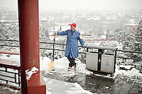 A employee of the Jingshan park(Coal Hill) takes a rest after  snowfalls that local authorities say they have artifically provoked to fight the exceptional drought in northern China. Feb. 13 2011