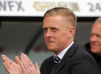 SWANSEA, WALES - MAY 17: Swansea manager Garry Monk applauds home supporters prior to the Premier League match between Swansea City and Manchester City at The Liberty Stadium on May 17, 2015 in Swansea, Wales. (photo by Athena Pictures/Getty Images)