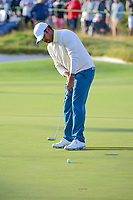 Anirban Lahiri (IND) watches his putt on 16 during round 3 Four-Ball of the 2017 President's Cup, Liberty National Golf Club, Jersey City, New Jersey, USA. 9/30/2017.<br /> Picture: Golffile | Ken Murray<br /> <br /> All photo usage must carry mandatory copyright credit (&copy; Golffile | Ken Murray)