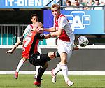 Nederland, Nijmegen, 19 augustus 2012.Eredivisie.Seizoen 2012-2013.N.E.C.-Ajax (1-6).Christian Eriksen van Ajax en Pavel Cmovs van N.E.C. strijden om de bal