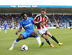 Gillingham's Deji Oshilaja tussles with Sheffield United's Chris Basham during the League One match at the Priestfield Stadium, Gillingham. Picture date: September 4th, 2016. Pic David Klein/Sportimage