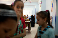 Children wait to perform a song as women listen to a speech by the Muslim Sisters. The meeting with local women was organized by the Muslim Sisters and took place at a school in the rural village of Al Saf, south of Cairo. Egypt. June 13th, 2012.