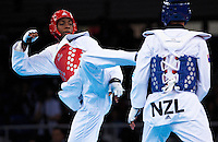 04 DEC 2011 - LONDON, GBR -  Muhammed Lutalo (GBR) (in red, on left) attempts to strike Vaughn Scott (NZL) (in blue, on right) during their men's -80kg category preliminary round contest at the London International Taekwondo Invitational and 2012 Olympic Games test event at the ExCel Exhibition Centre in London, Great Britain .(PHOTO (C) NIGEL FARROW)