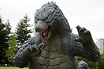 """July 18, 2014, Tokyo, Japan - A 6.6 meter model of the new Godzilla is displayed at Tokyo Midtown on July 18, 2014, Tokyo. The statue is a 1/7 scale reproduction of the 180 meters tall Hollywood film version of """"GODZILLA"""".  Godzilla and its footprints will be displayed from July 18 to August 31 during which time it will perform a special show using mist, light and sound effects every 30 minutes between 19:00 to 21:00. (Photo by Rodrigo Reyes Marin/AFLO)"""
