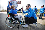 Rangers captain Lee McCulloch gives a high five to fan Abigail Webster, 7 from Paisley as supporters group Sons of Struth take a party of disabled kids on a tour of the training ground this morning