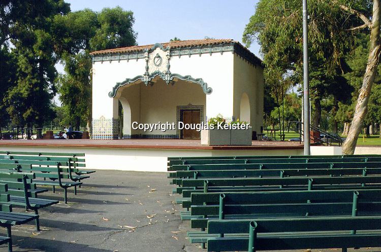The mania for Spanish Baroque detailing engendered by Goodhue's Panama-California Exposition soon spread to structures of all kinds.  In the early Twenties, the city of Long Beach, which took special pride in supporting year-round band concerts, chose the style for its new bandshell at Recreation Park.  Hence, the proscenium arch is adorned with modest sweeps of Churrigueresque ornament, though its elliptical form is forever at odds with the round-arched side openings.  Additional ornament bands the cornice, and a wainscot of superb Malibu tile wraps the columns.  The bandshell served as a temporary classroom following the massive earthquake that struck Long Beach in 1933, and was also the venue for an early political appearance by Richard Nixon.