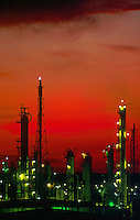 Oil refinery at dusk. Dramatic red sky caused by air pollution.