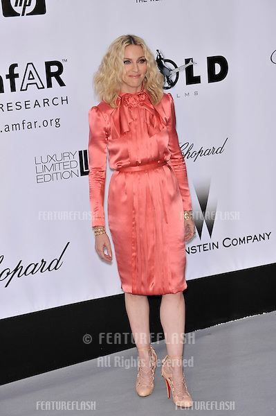 Madonna at amfAR's Cinema Against AIDS 2008 Gala at Le Moulin de Mougins restaurant. The event is part of  the 61st Annual International Film Festival de Cannes. .May 22, 2008  Cannes, France..Picture: Paul Smith / Featureflash