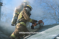 63818-01606 Firefighter using saw to ventilate smoke from house fire  Kinmundy-Alma Fire District,  Kinmundy IL