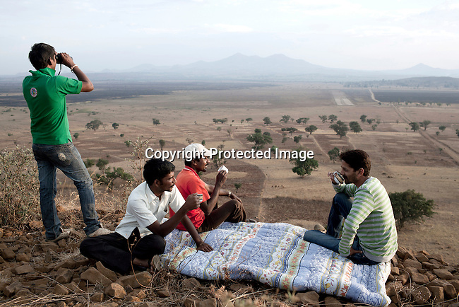 BAKO, ETHIOPIA - MARCH 9: Indian manager and workers have tea from the top of the hill where they live on a farm leased by the Ethiopian government to the Indian company Karuturi Global Limited on March 9, 2011 in Bako, Ethiopia. Photo by: Per-Anders Pettersson