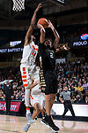 Donovan Mitchell (2) of the Wake Forest Demon Deacons drives to the basket past Oshae Brissett (11) of the Syracuse Orange during second half action at the LJVM Coliseum on January 3, 2018 in Winston-Salem, North Carolina.  The Demon Deacons defeated the Orange 73-67.  (Brian Westerholt/Sports On Film)