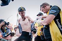 Antwan Tolhoek (NED/LottoNL-Jumbo) changing into something dry after finishing for the descent back down<br /> <br /> Stage 6: Brest > Mûr de Bretagne / Guerlédan (181km)<br /> <br /> 105th Tour de France 2018<br /> ©kramon
