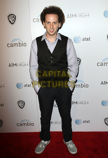 "Josh Sussman.""Aim High"" Los Angeles Premiere held at Trousdale, West Hollywood, California, USA..October 18th, 2011.full length black waistcoat purple shirt hands in pockets .CAP/ADM/KB.©Kevan Brooks/AdMedia/Capital Pictures."