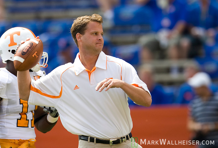 Tennessee head coach Lane Kiffin passes with his quarterbacks prior to the start of the NCAA football game between the Tenessee Volunteers and the number one ranked Florida Gators in Gainesville, FL September  19, 2009.    (Mark Wallheiser/TallahasseeStock.com)