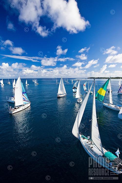 Yachts racing in the second leg of the Tahiti Pearl Regatta, from Bora Bora to Tahaa