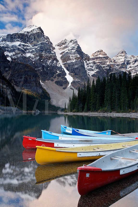 Canoes floating on Moraine Lake on a quiet morning, Valley of the Ten Peaks, Banff National Park, Canadian Rockies, Alberta, Canada