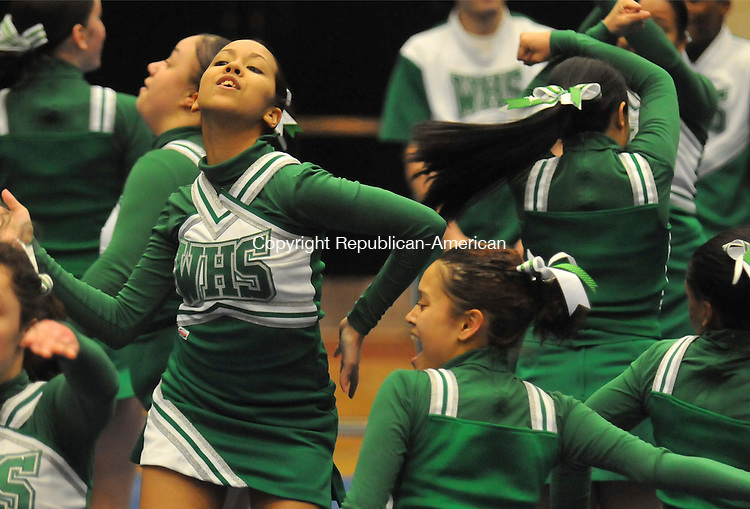 WATERBURY, CT-01 MARCH 2009-030110IP03-Casee Fernandez (left) of the Wilby High School cheerleading team competes with her teammates during the NVL cheerleading championships at Crosby High School in Waterbury on Monday. <br /> Irena Pastorello Republican-American