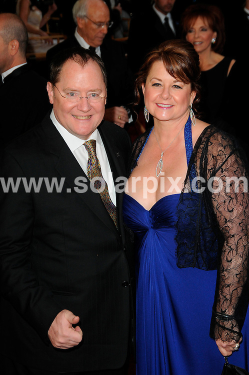 **ALL ROUND PICTURES FROM SOLARPIX.COM**                                             **SYNDICATION RIGHTS FOR UK, AUSTRALIA, DENMARK, PORTUGAL, S. AFRICA, SPAIN & DUBAI (U.A.E) & ASIA (EXCLUDING JAPAN) ONLY**                                                                                  Arrivals for the 83rd Annual Academy Awards, Kodak Theatre, Hollywood, CA, USA.                                                                        .This pic:    John Lassiter and wife Nancy.JOB REF:    12901    PHZ/Evans       DATE: 27.02.11                                                           **MUST CREDIT SOLARPIX.COM OR DOUBLE FEE WILL BE CHARGED**                                                                      **MUST AGREE FEE BEFORE ONLINE USAGE**                               **CALL US ON: +34 952 811 768 or LOW RATE FROM UK 0844 617 7637**