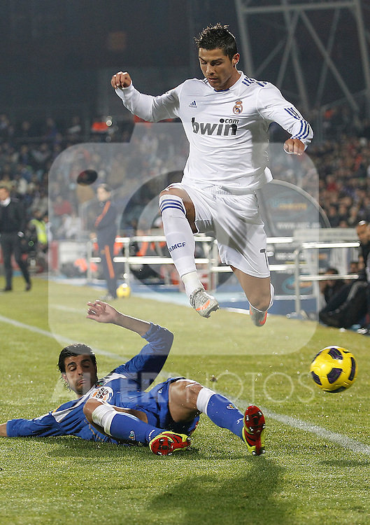 Getafe's Miguel Torreas and Real Madrid's Cristiano Ronaldo during la Liga match on January 3rd 2011...Photo: Cesar Cebolla / ALFAQUI