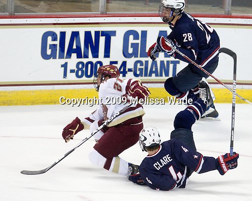 Steven Whitney (BC - 21), Stephen Johns (US - 28), Kevin Clare (US - 4) - The Boston College Eagles defeated USA Hockey's National Team Development Program's Under 18 team 6-3 on Friday, October 9, 2009 at Conte Forum in Chestnut Hill, Massachusetts.