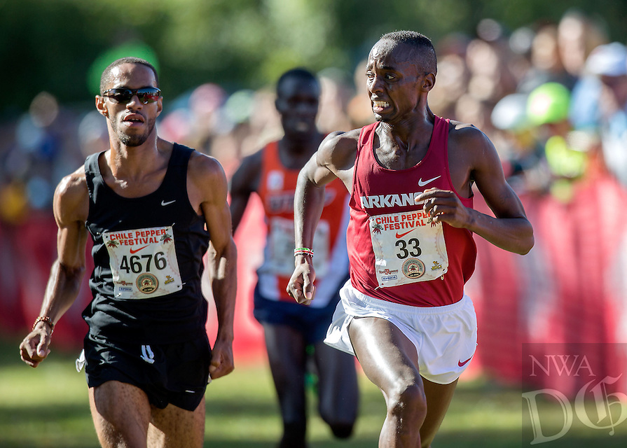 NWA Media/JASON IVESTER --10/04/2014--<br /> Arkansas senior Stanley Kebenei (right), looks back to second place runner, Kemoy Campbell, as they approach the finish in the collegiate 8K on Saturday, Oct. 4, 2014, during the 26th annual Chile Pepper Cross Country Festival at Agri Park in Fayetteville. To see more photos, go to nwaonline.com/photos.
